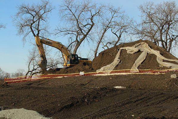 Mound of soil beside an excavator