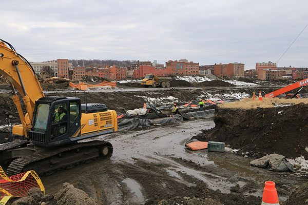 Excavators dig foundations for the luxury apartment building