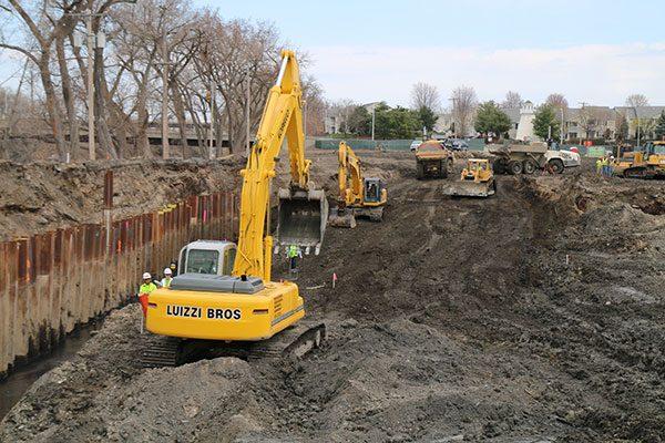 Luizzo Bros excavators remove soil from the Starbuck Island job site
