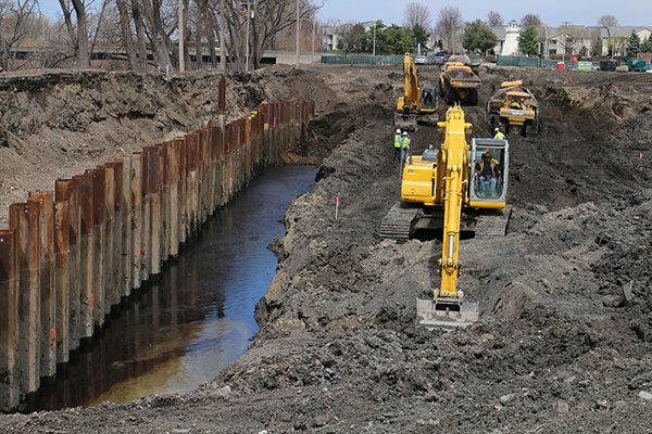 Luizzi excavators and dump trucks working on the Starbuck Island oil remediation project