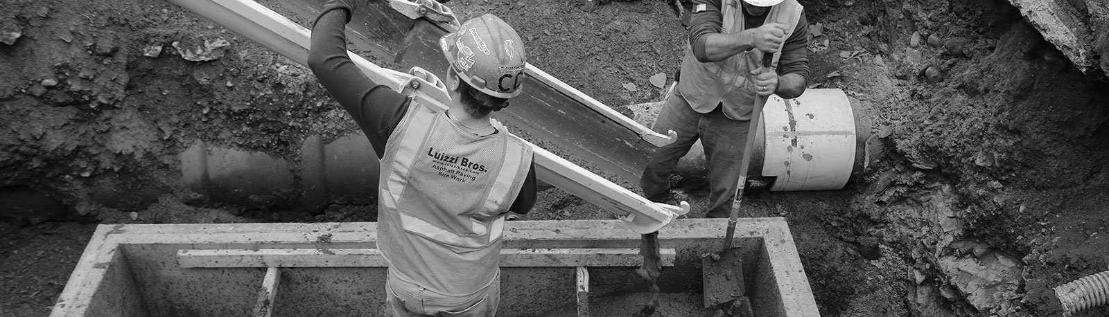 Luizzi Bros workers pouring cement