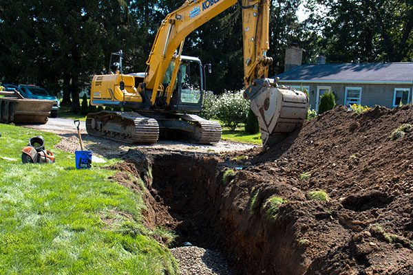 Excavator digs trench in residential area of Halfmoon NY