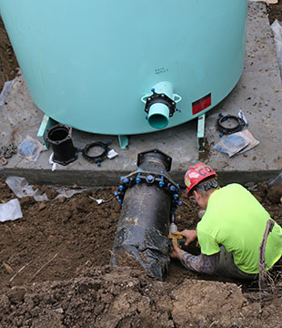 Luizzi Bros employee repairs stormwater pipe in Halfmoon NY
