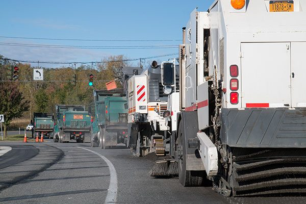 Milling trucks at traffic light on Albany Shaker Road