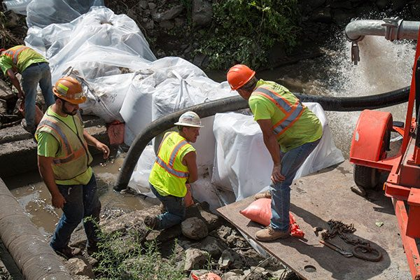 Workers in hard hats on a stormwater construction site