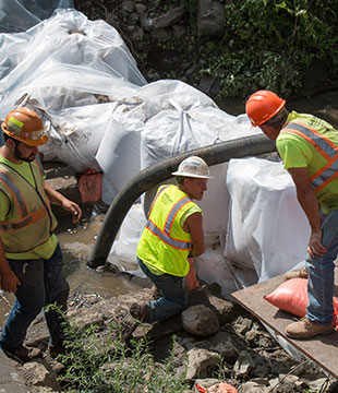 Men in hard hats work on Halfmoon water district replacement project