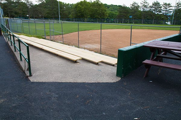Newly constructed bleachers in front of the baseball diamond in Arbor Hill