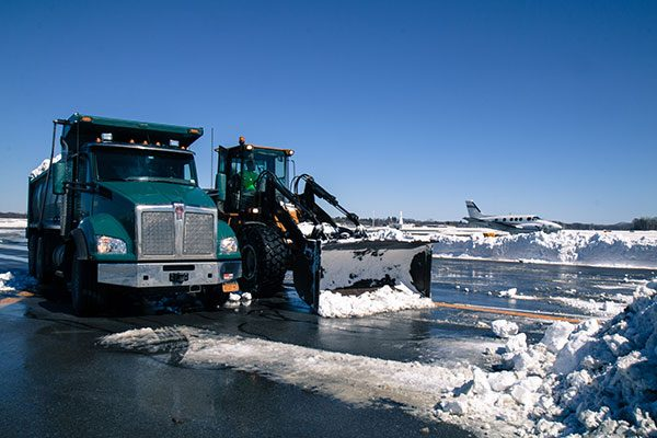 Luizzi Bros snow removal equipment parked at Albany County Airport