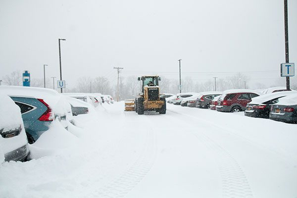 Luizzo Bros. snow plowing in an Albany parking lot
