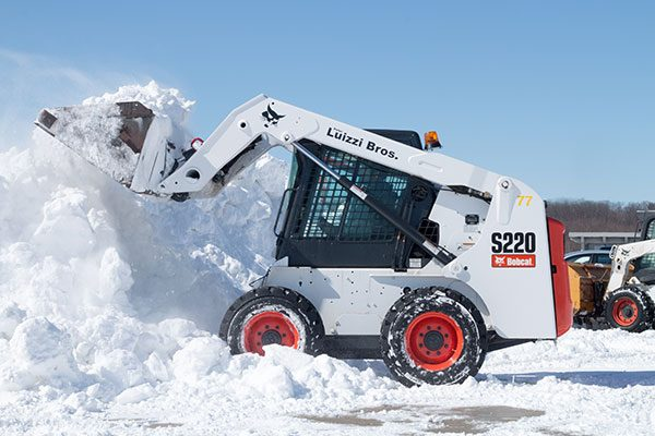 Luizzi Bros. Skid-Steer Loader removing snow