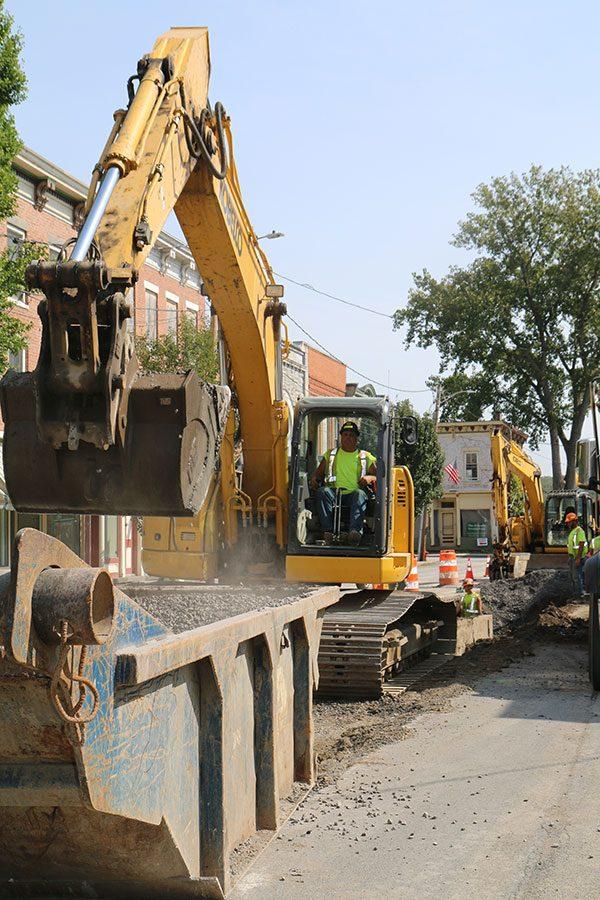 Heavy equipment operator inside an excavator