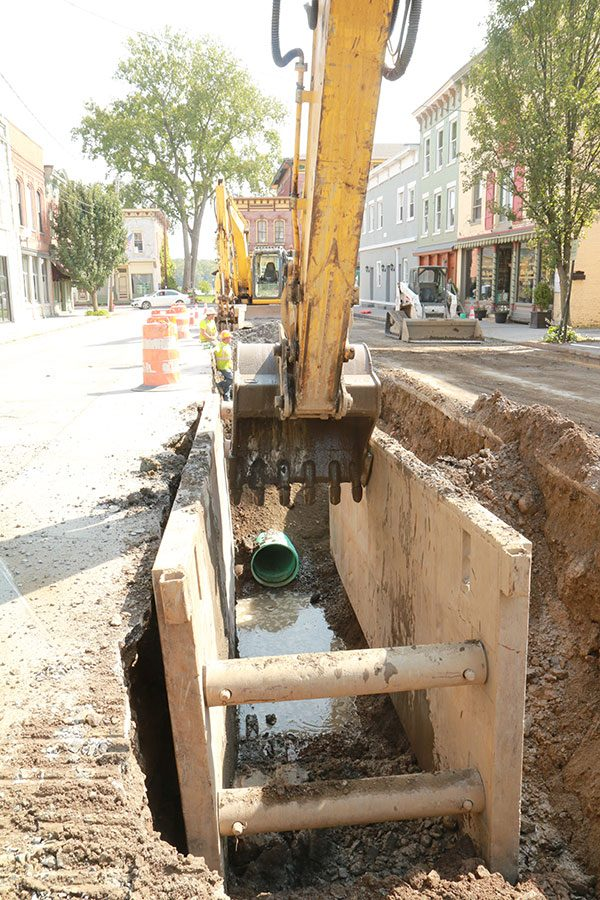 Trench on Main Street in Coxsackie with excavator