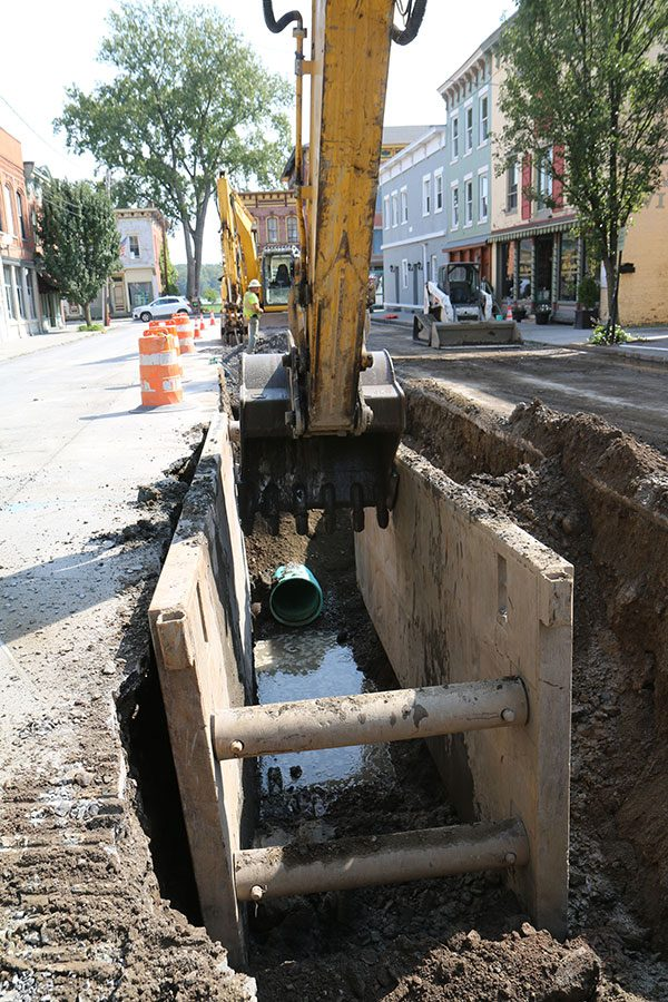 Excavator in trench on Main Street in Coxsackie