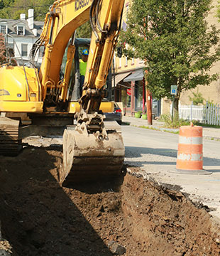Excavator digs trench for Coxsackie sewer project