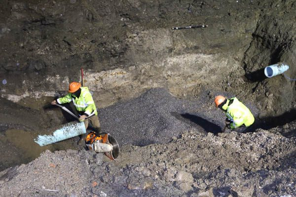 Two workers leveling the gravel