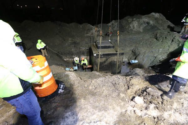 Crew guiding the PRV Vault in the hole
