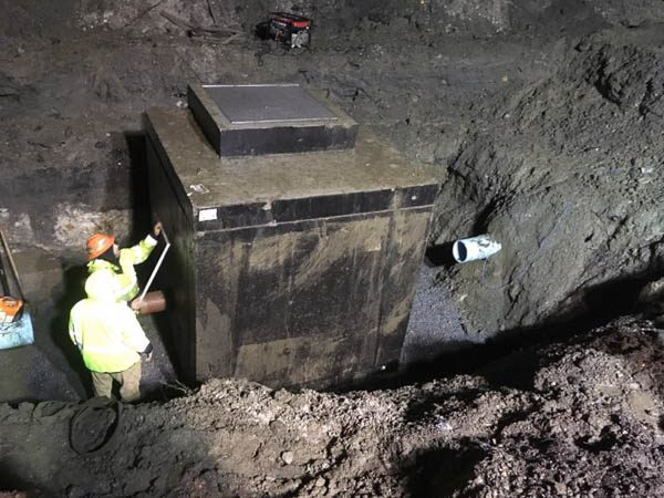 Crew checking the placement of the vault