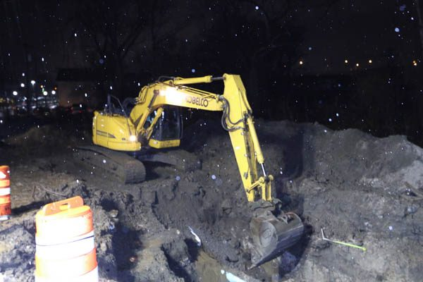 Excavator digging the new hole for the vault