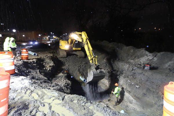 Excavator dumping gravel