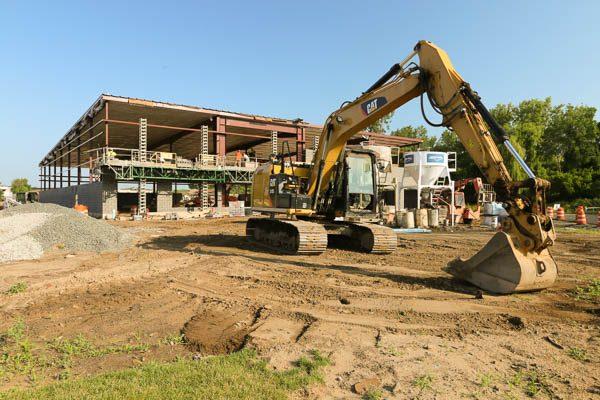 Excavator outside framed building