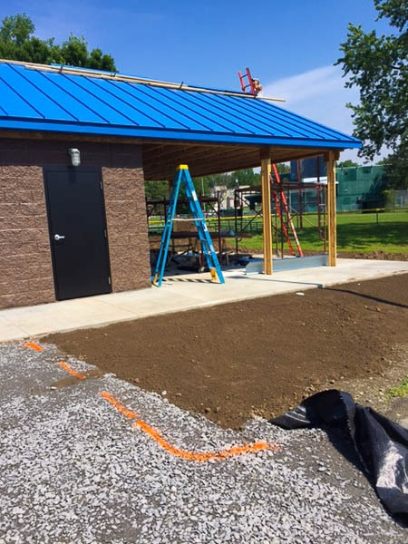 Concession Stand being built with a ladder in the photo