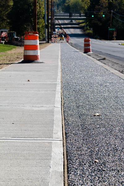 sidewalk with safety cone