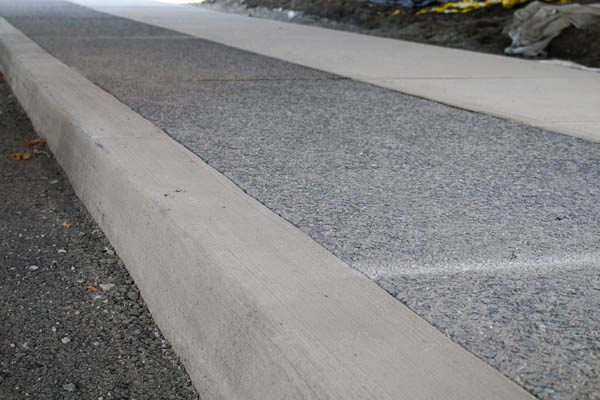 asphalt beside walkway