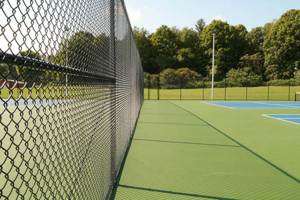 Fencing surrounding the tennis court