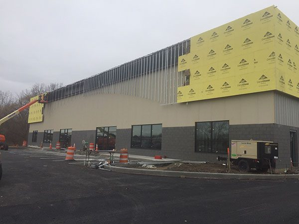 Luizzi Construction in Albany NY uses a bucket lift to complete new construction