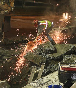 Worker cutting rebar