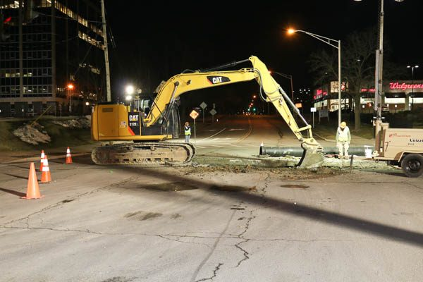 Excavator in the middle of the road
