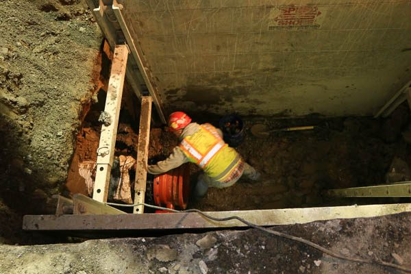Worker in the trench box
