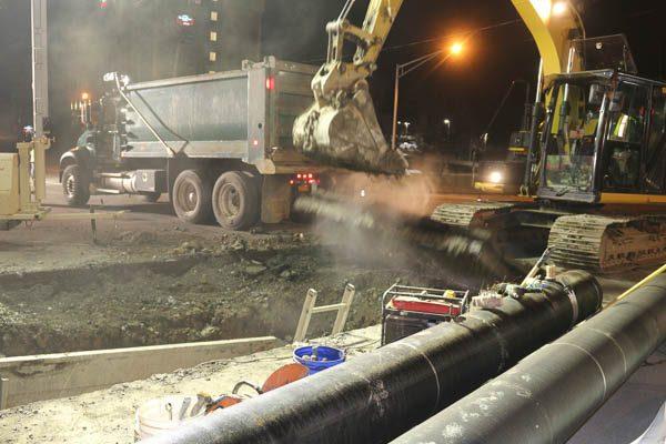 Excavator picking up debris