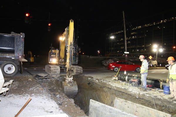 Excavator digging up ground debris