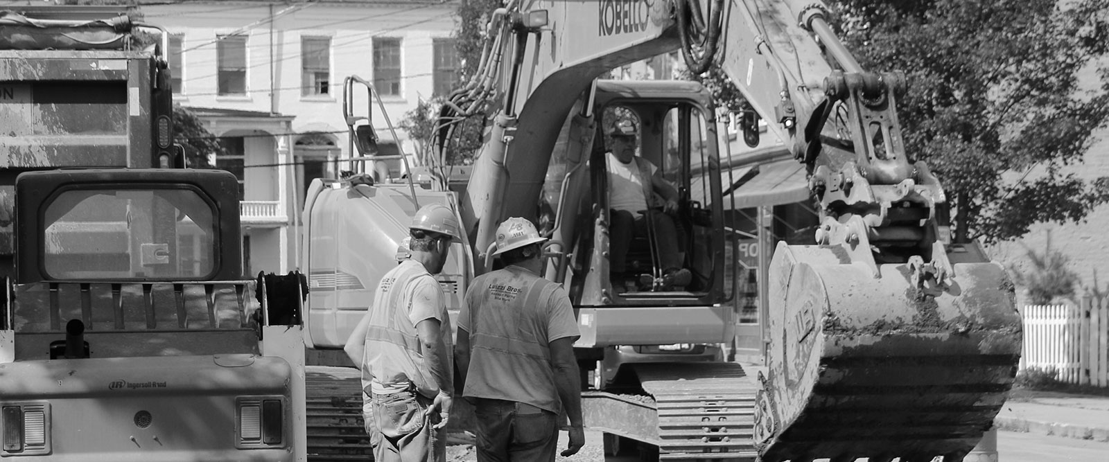 Luizzi employees in hard hats with Excavator