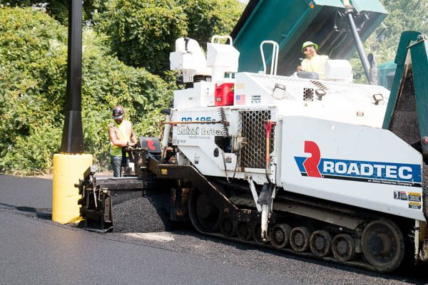 paving machine laying asphalt