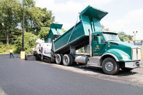 Luizzi Dump truck filling the paving machine