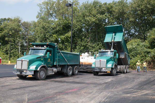two dump trucks