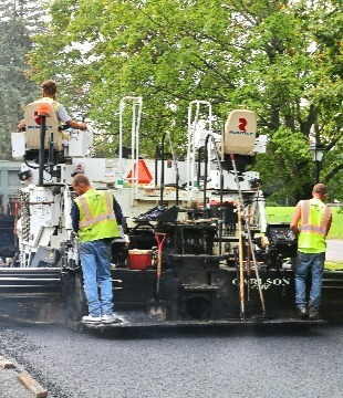 Construction workers paving in Presidential Estates in Guilderland