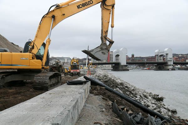 Sea Wall Redi Rock installation using an excavator