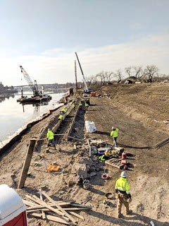 View of the island, barge and crew working