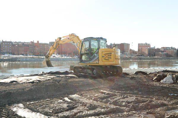 Excavator straightening redi rock