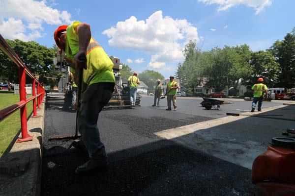 crew laying asphalt