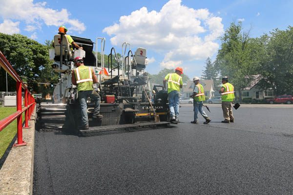 crew operating a paver