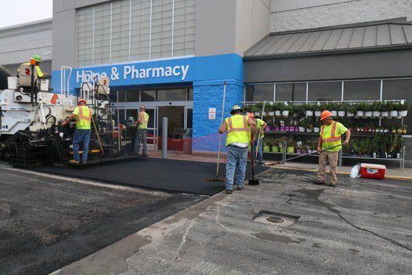 crew smoothing asphalt