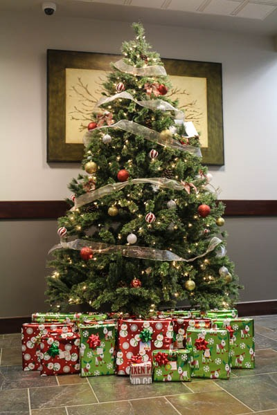 Christmas tree with gifts for donation