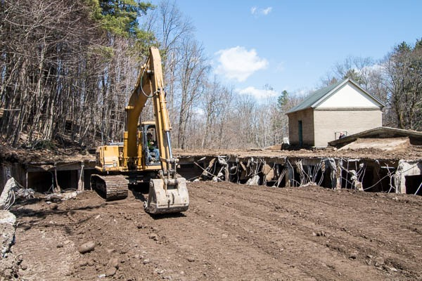 Excavator in front of Demolition work