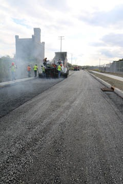 Crew paving Tory Industrial Road